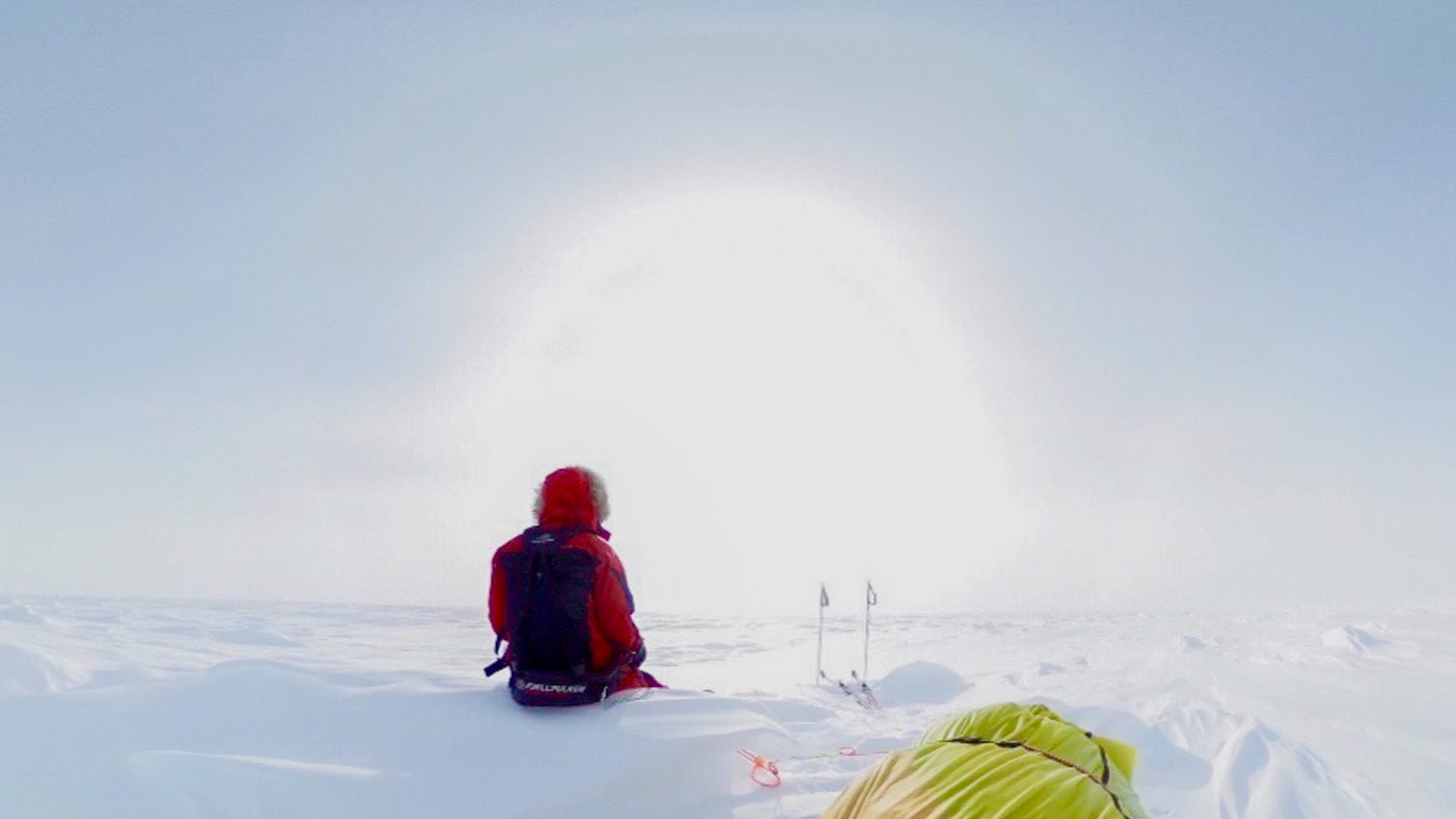 Colin O'Brady looks out at the sun during his unsupported journey through Antarctica.