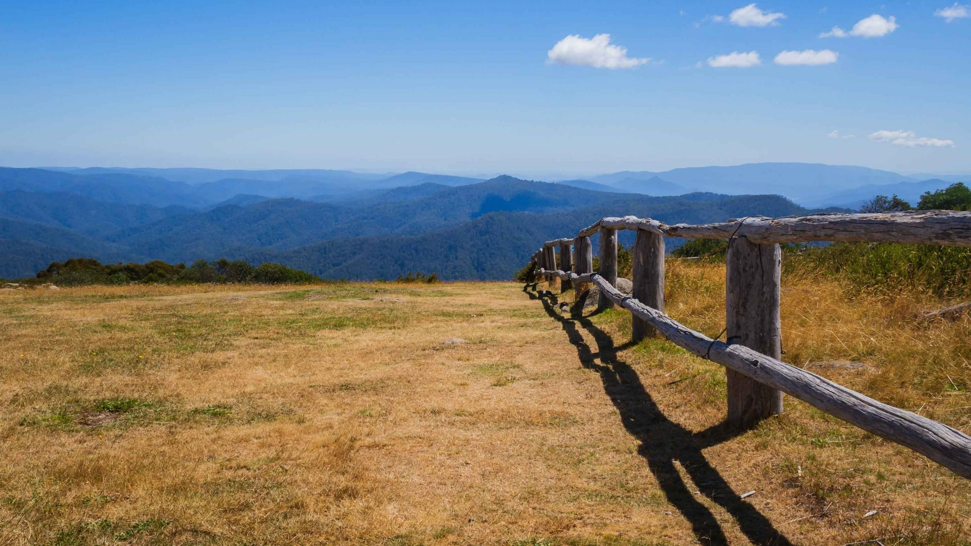 A fence leads to a spectacular vista at Craigs Hut in Australia.