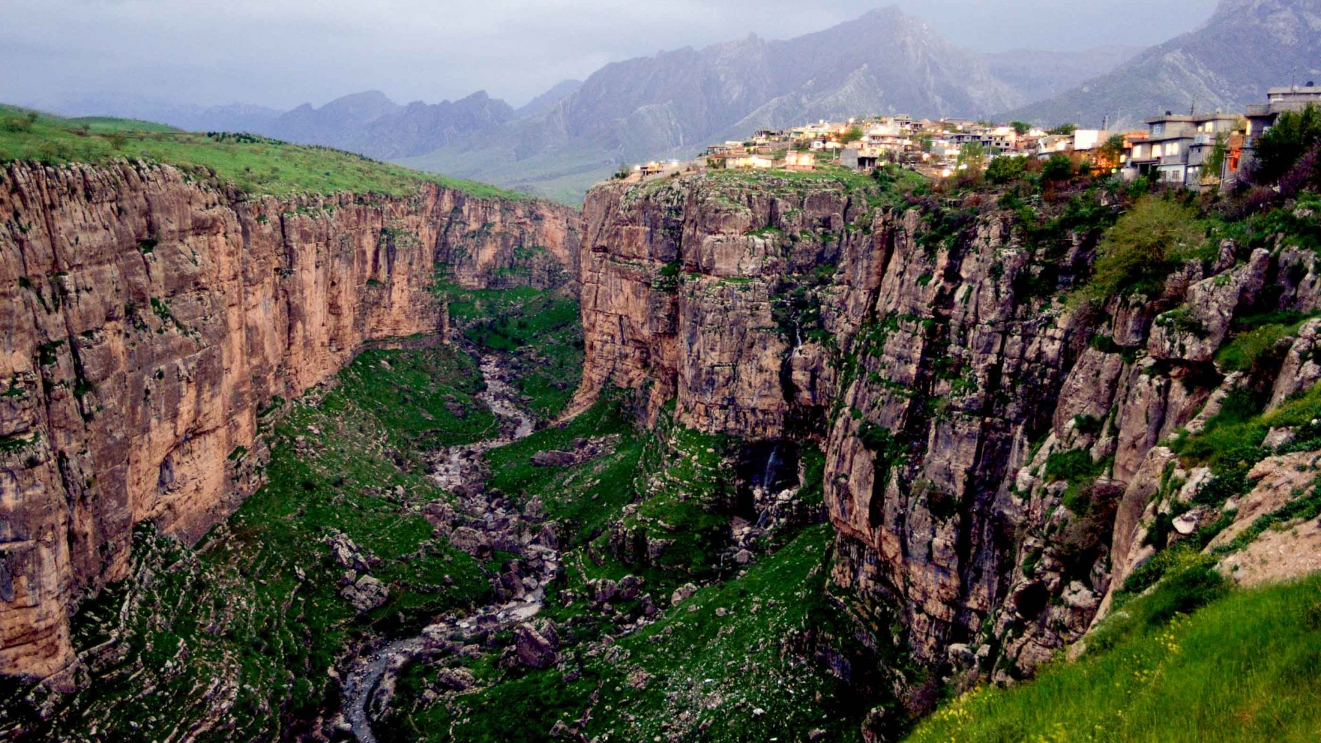 A small village sits above a dramatic escarpment in Iraqi Kurdistan.