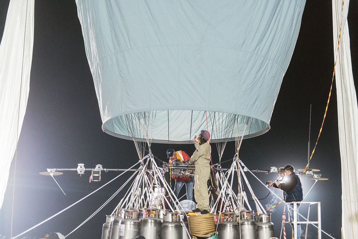 Konyukhov tends to some essential balloon maintenance—there's no margin for error on his expeditions.