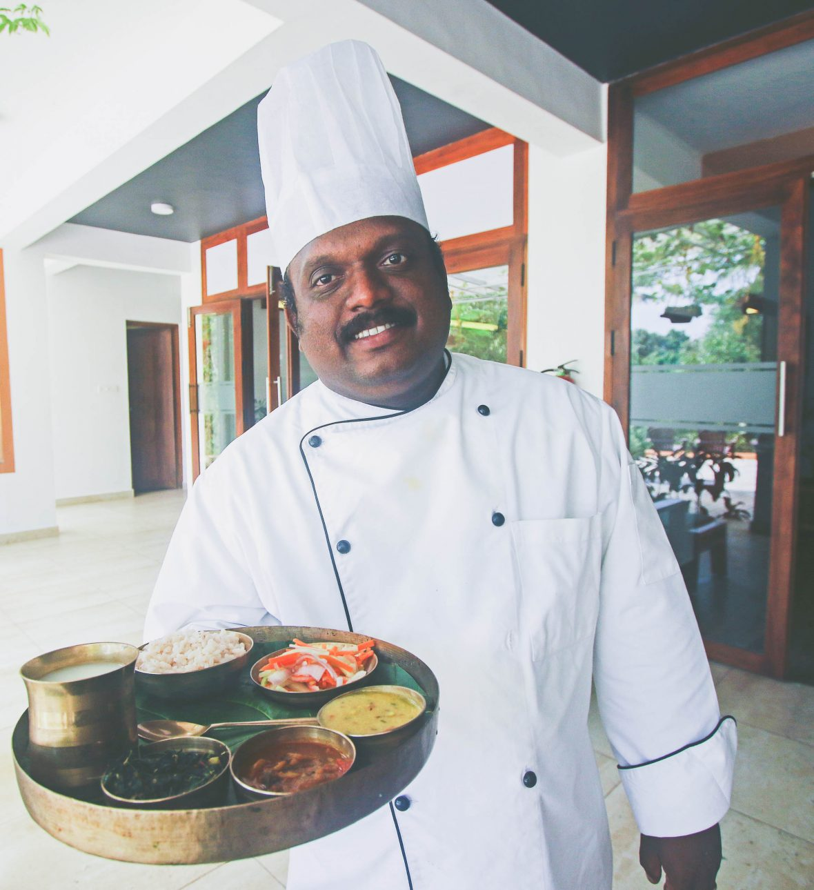 A chef prepares meals consistent with an Ayurveda diet.