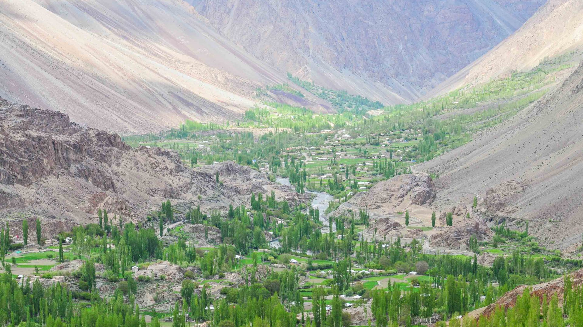 Villages in Pakistan surrounded by arid peaks.