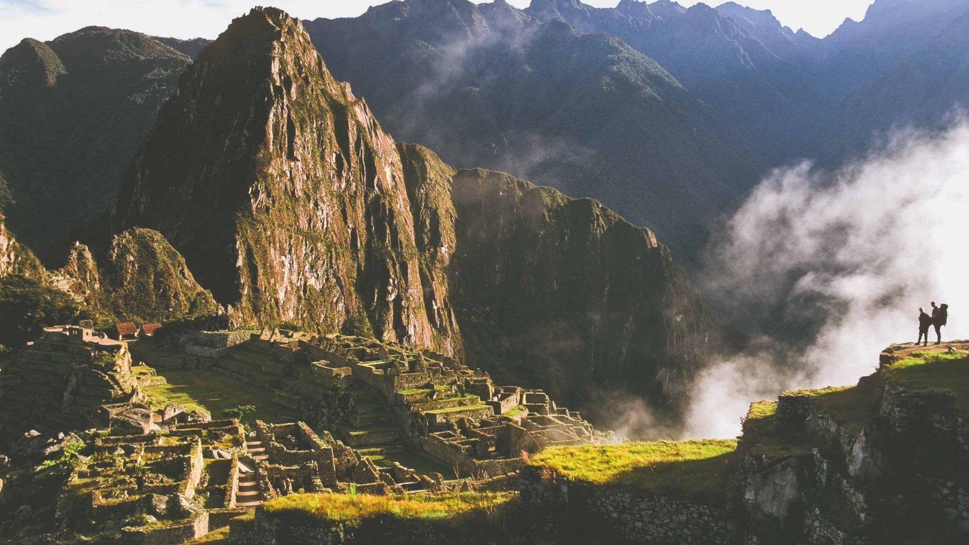 Hikers look out over Machu Picchu.