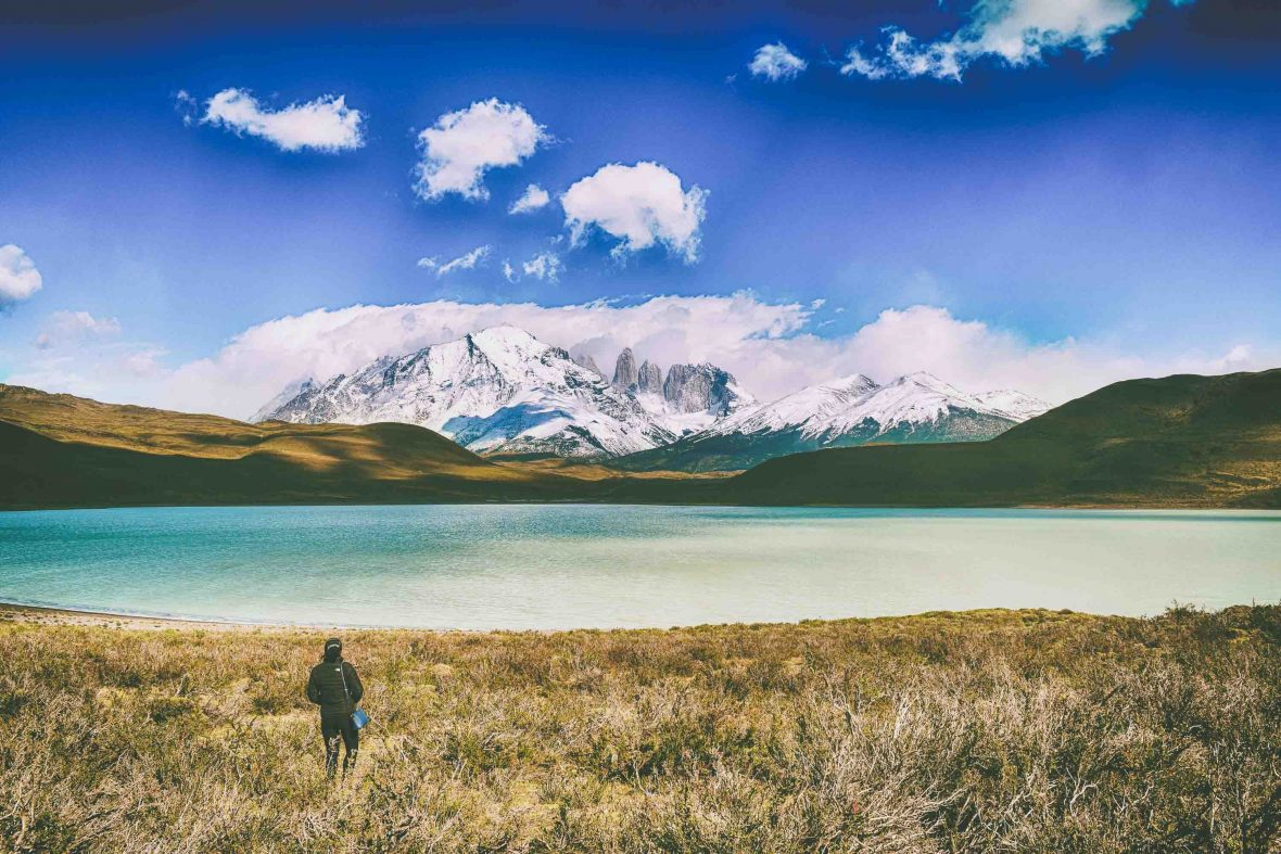 A hiker looks out at the view over Torres del Paine National Park, Chile.