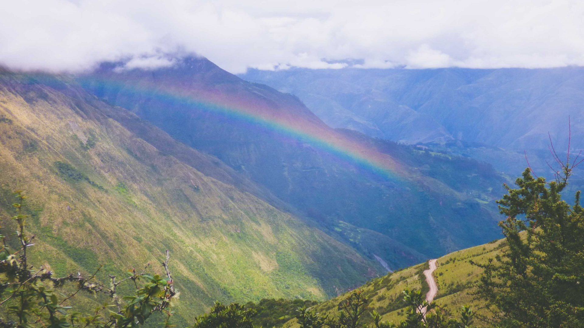 A rainbow falls over the valley during the Salkantay hike in Peru.