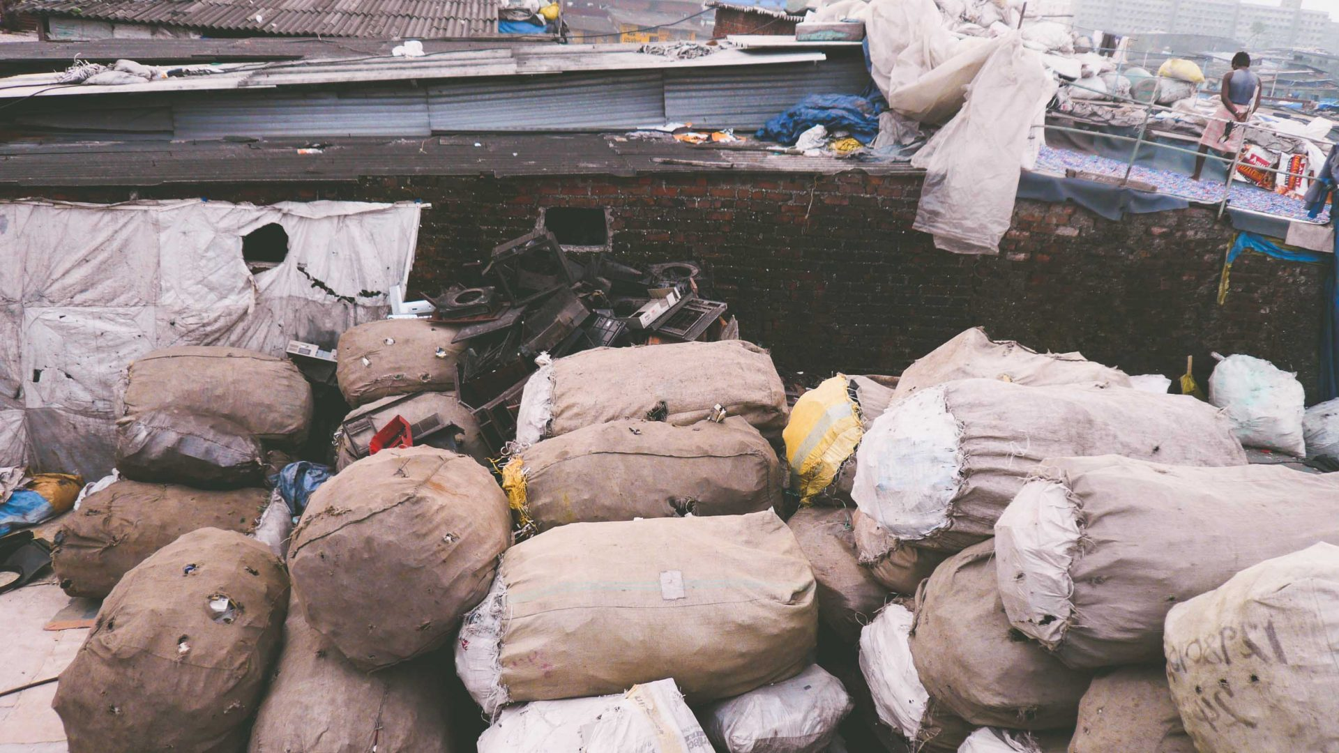 Plastic recycling bundled into bags upon a rooftop in Dharavi slum in Mumbai.