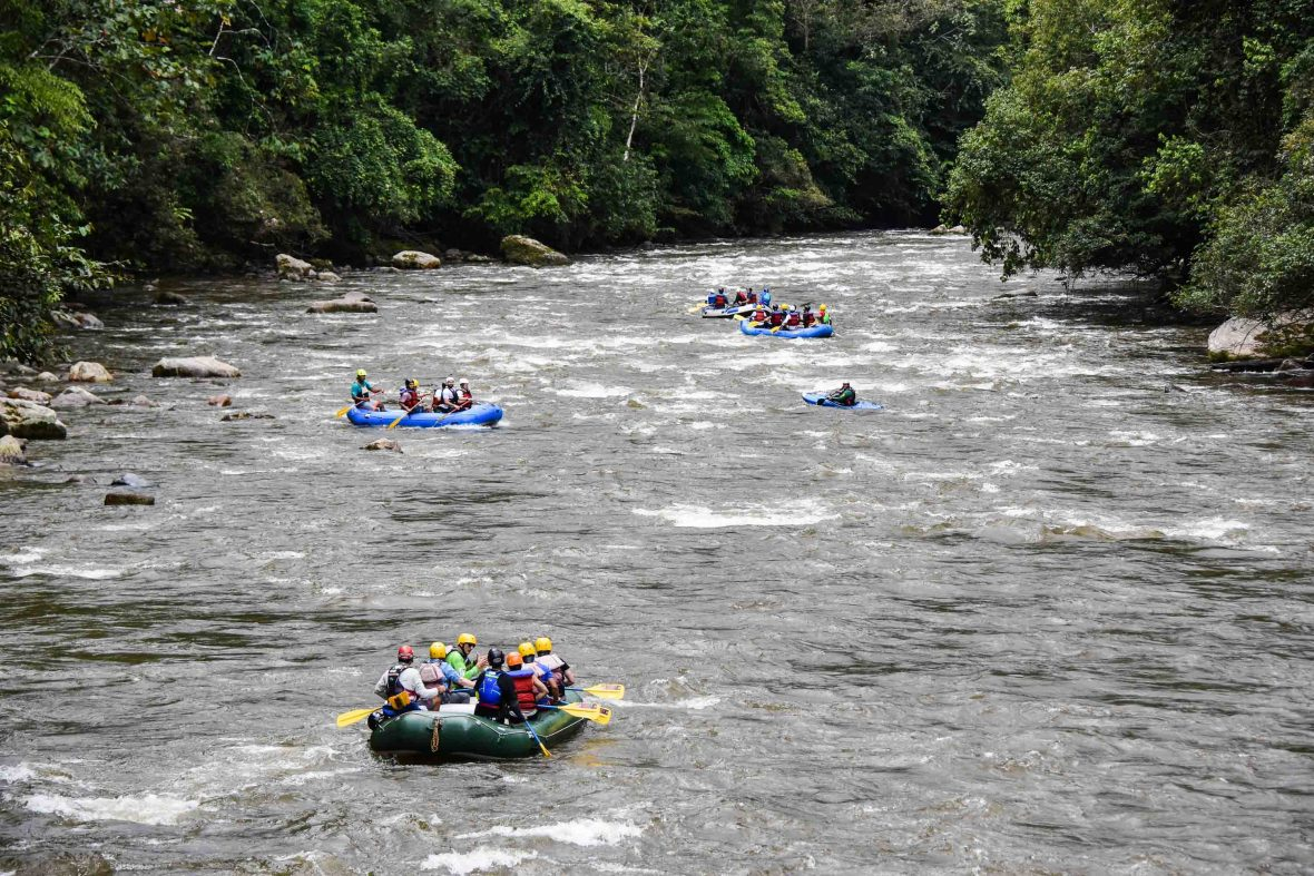 Three rafts guided by former combatants go down the Pato River in San Vicente del Caguán, Colombia.