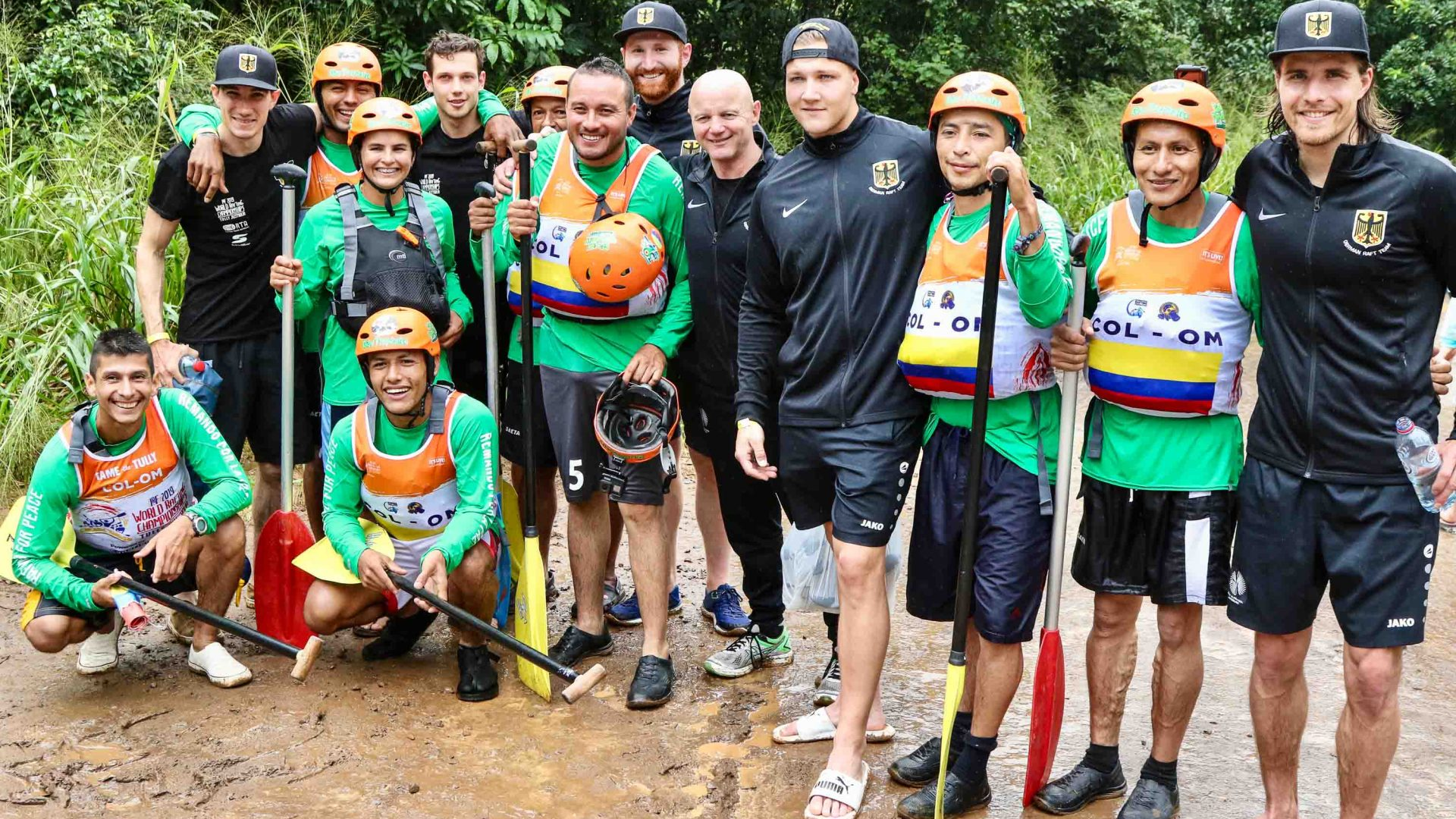 The Colombian and German teams at the World Rafting Championships; the Colombian team had found out they were going to be racing the German team.