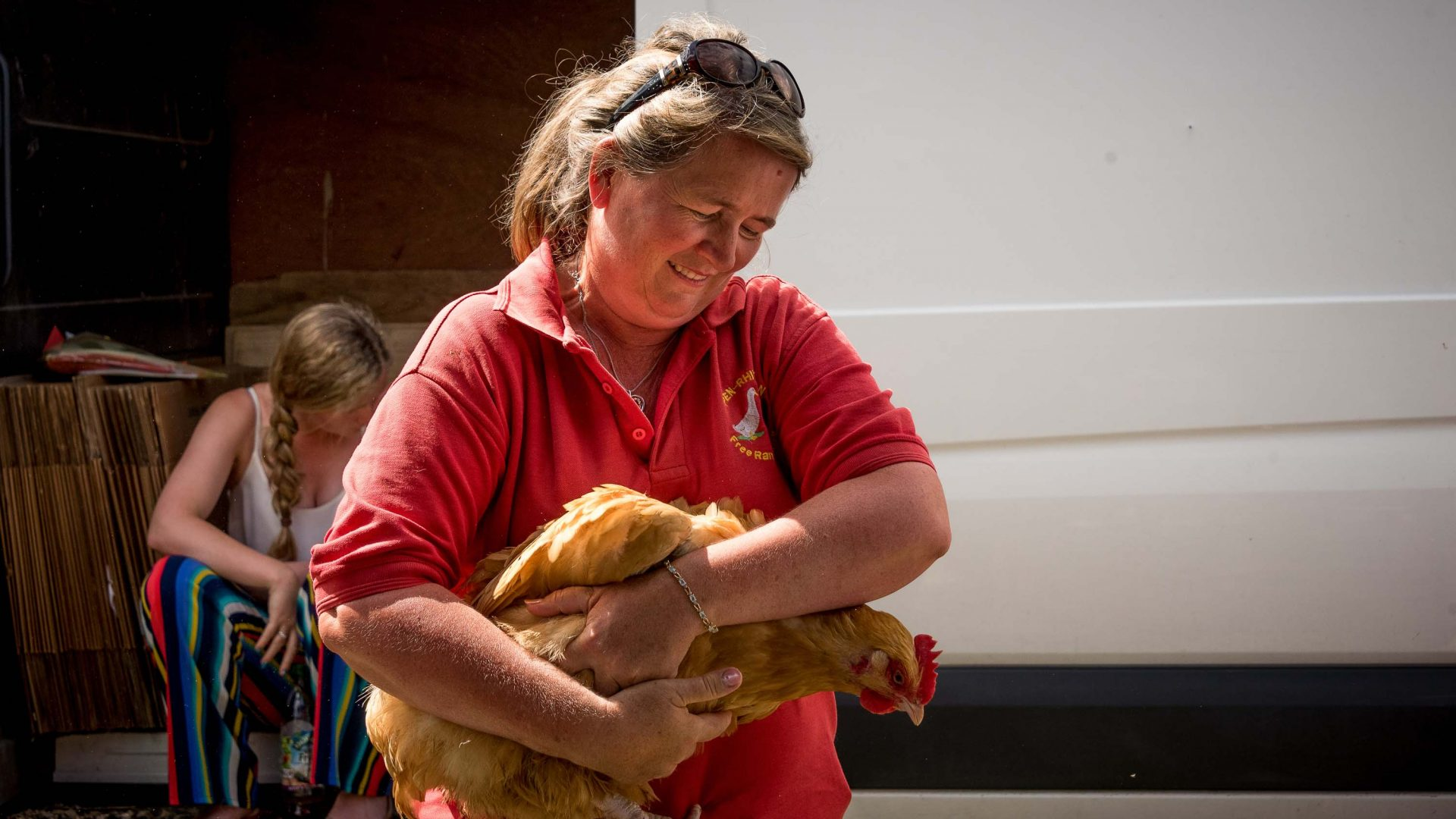 A woman tenderley handles a chicken at the Llanthony Valley and District Show.
