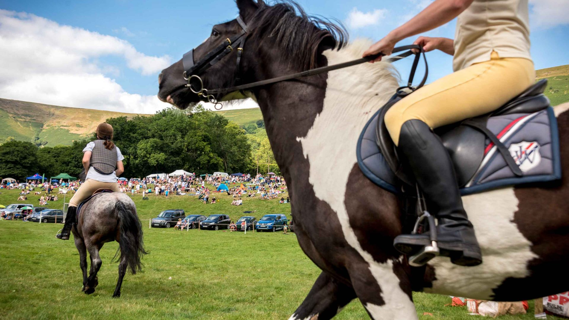 Riders take part in horse-based activities at the Llanthony Valley and District Show in Wales.