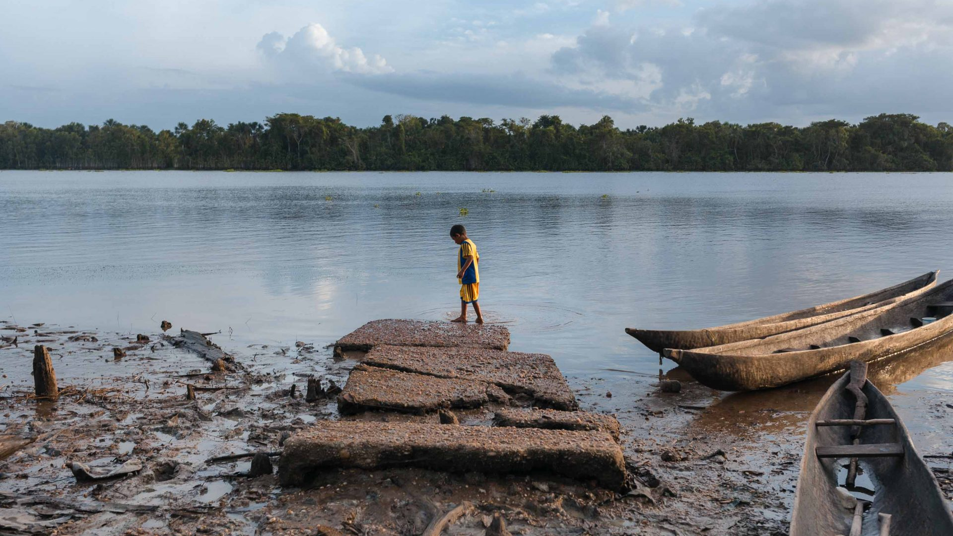 A Warao child walks on the remains of a concrete pier in the Orinoco River, Venezuela.