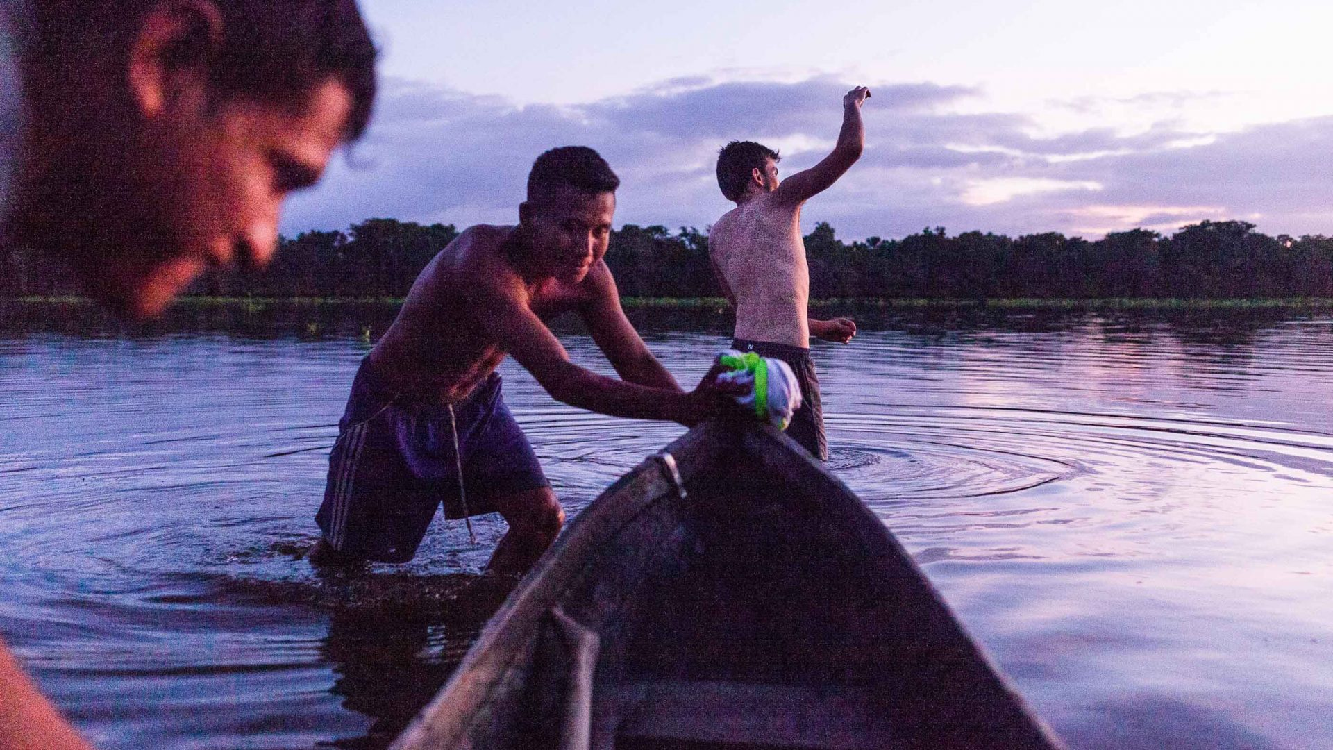 Warao teenagers play along the Orinoco River in Venezuela.