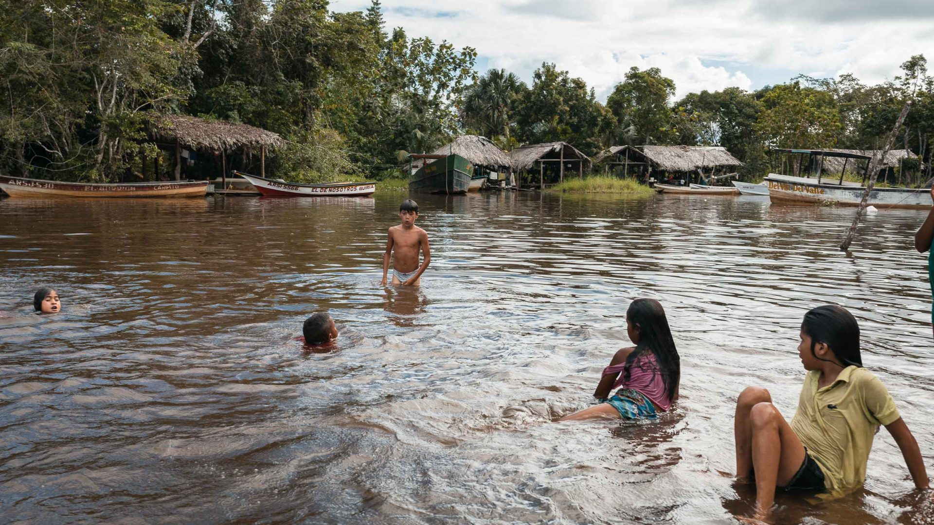 Warao children play on the waters of Venezuela's Orinoco River.