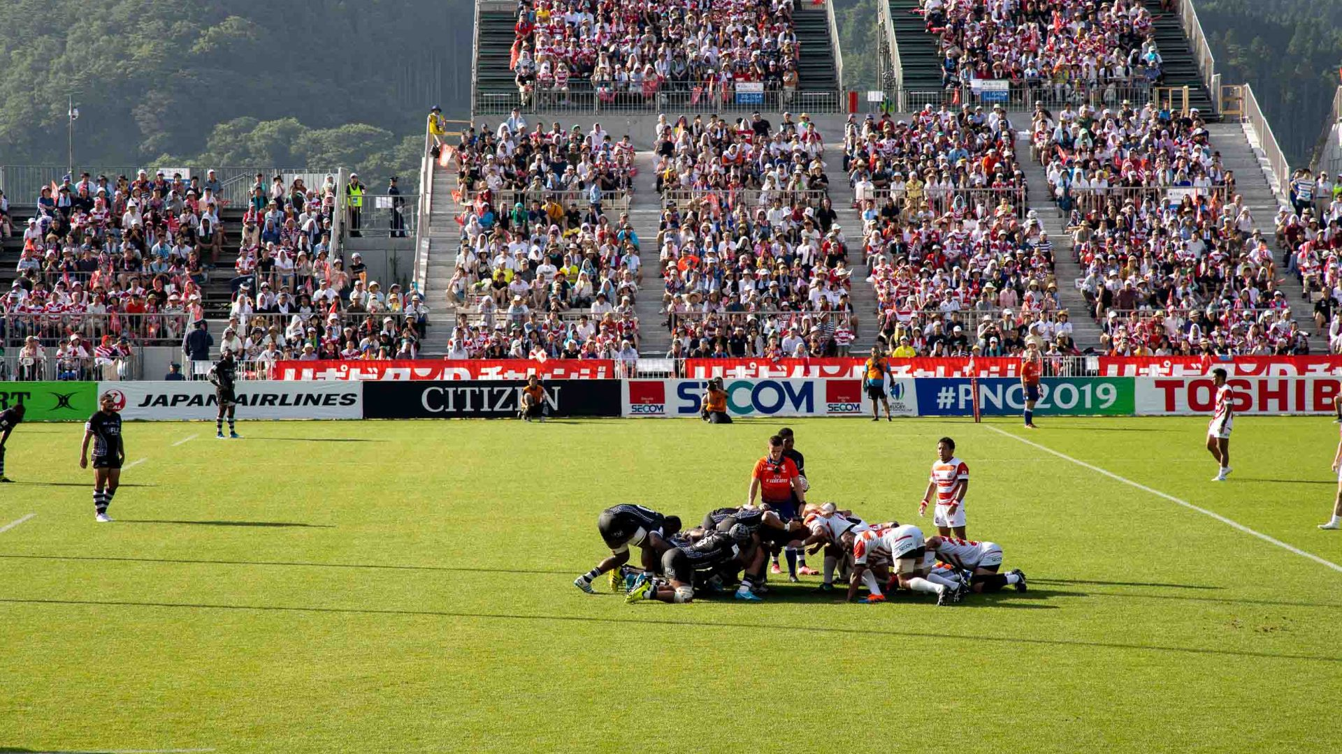 Players compete during the first international match at the Kamaishi Memorial Recovery Stadium, between Japan and Fiji.