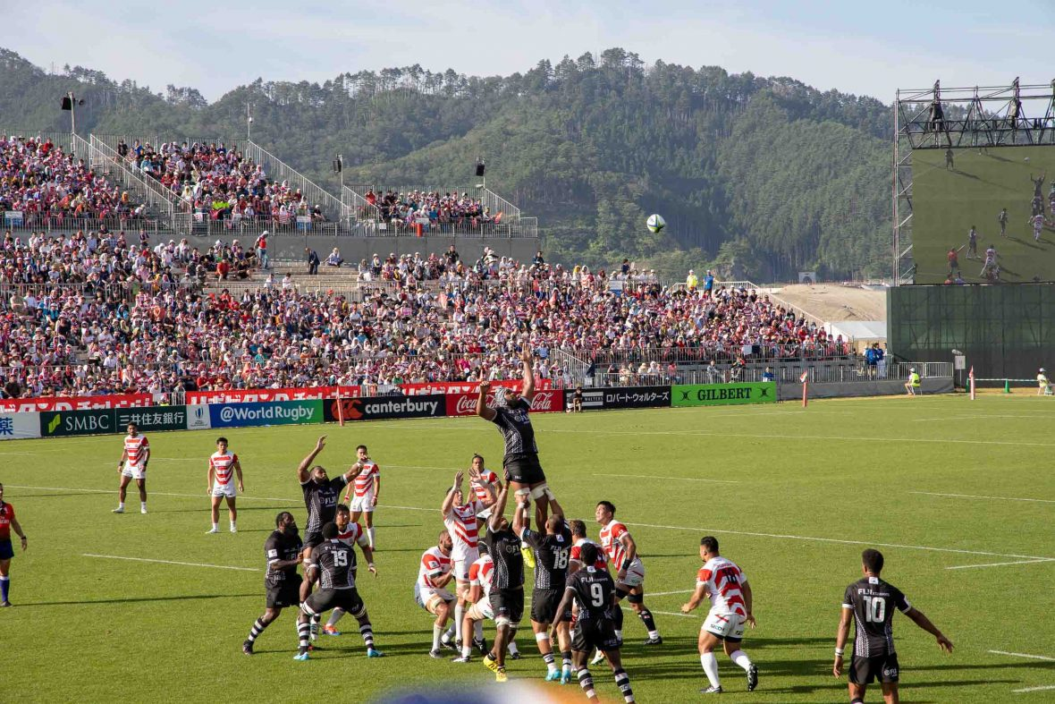 Players from Japan and Fiji compete during the first international match at the Kamaishi Memorial Recovery Stadium.