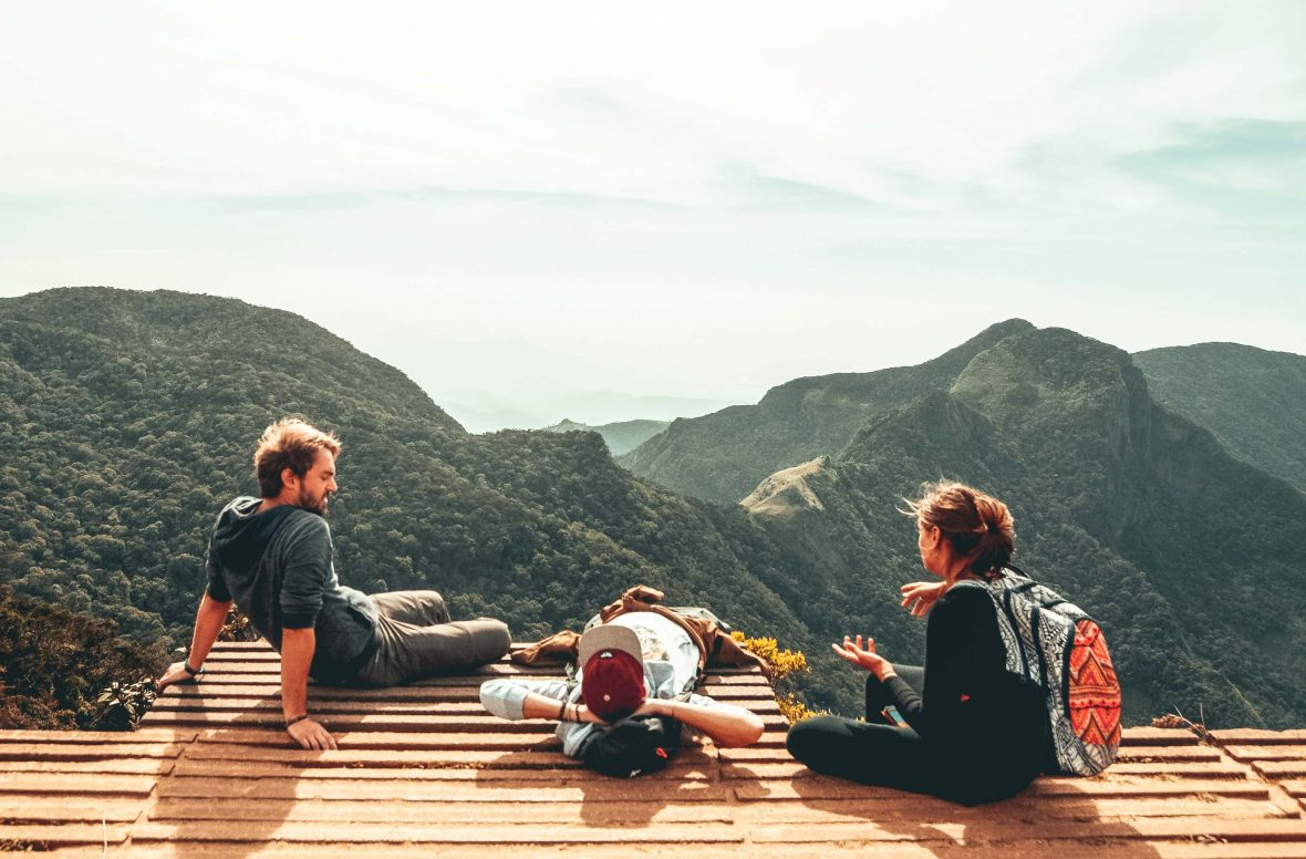 Tourists relax overlooking the mountains in Horton Plains National Park in the central highlands of Sri Lanka.