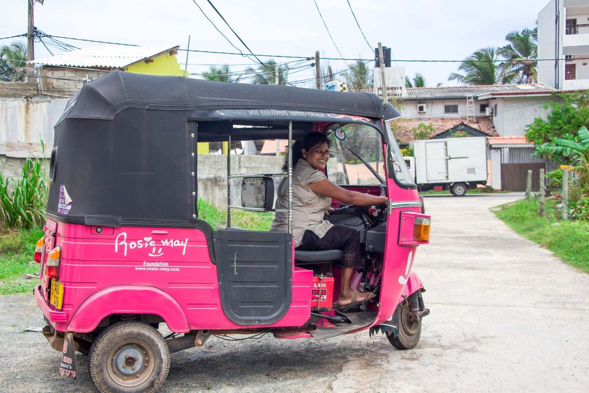 Deepika Priyadarshani drives her pink tuk-tuk to support her daughter's education.