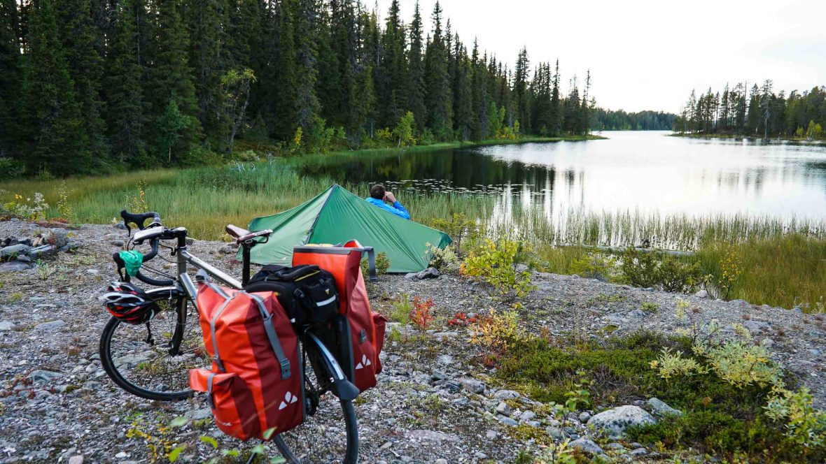 Simon enjoys lakeside serenity in Swedish Lapland at a campsite during his 3,200-kilometer ride across the Scandinavian Peninsula.