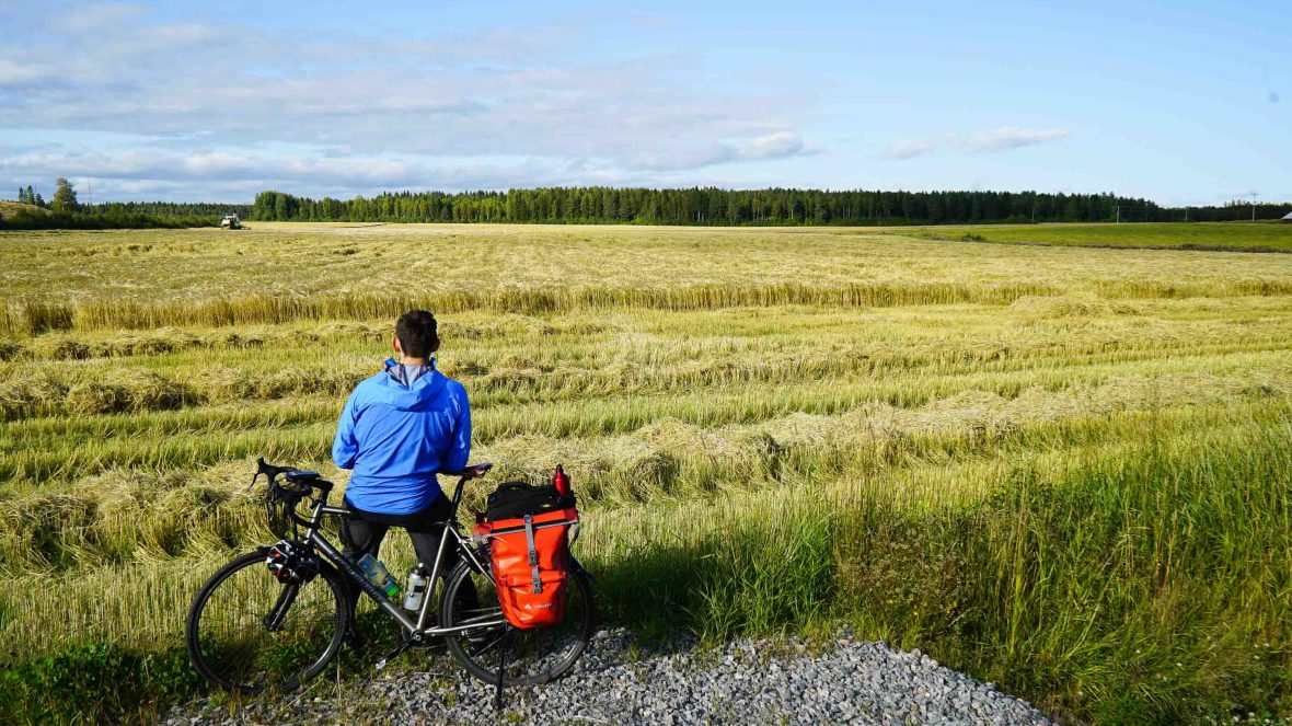 Simon stops to rest during his 3,200-kilometer ride across the Scandinavian Peninsula.