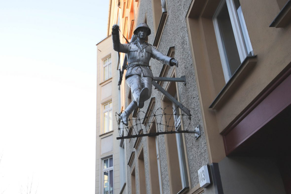 """A sculpture of Conrad Schumann's iconic """"leap of freedom"""". The East German border guard was snapped jumping over the wall as he defected in 1961."""