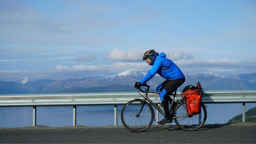 Simon Parker cycles along the Scandinavian Peninsula while filming Earth Cycle.