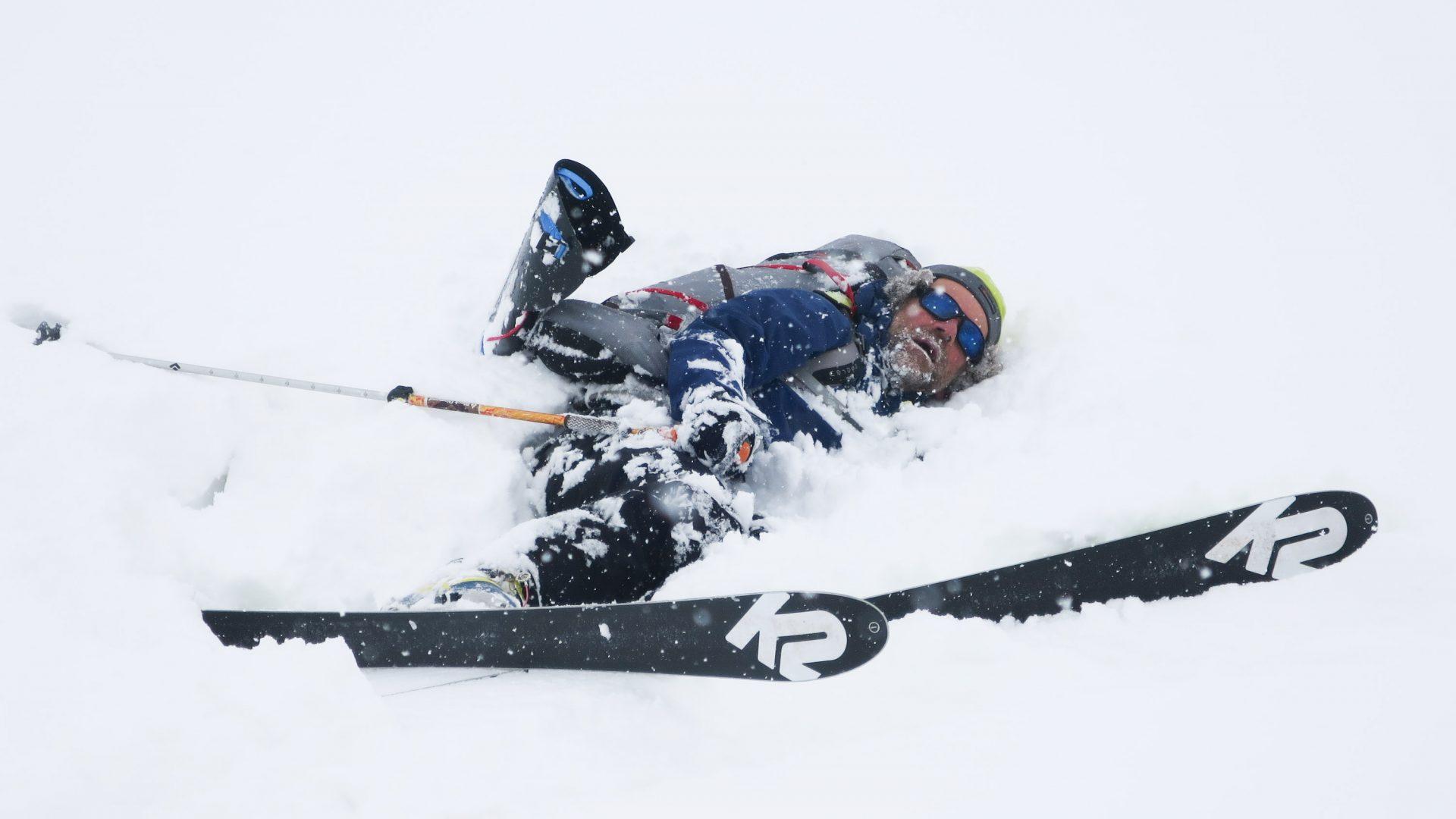 Huw Kingston flat on his back in the snow of Tajikistan.
