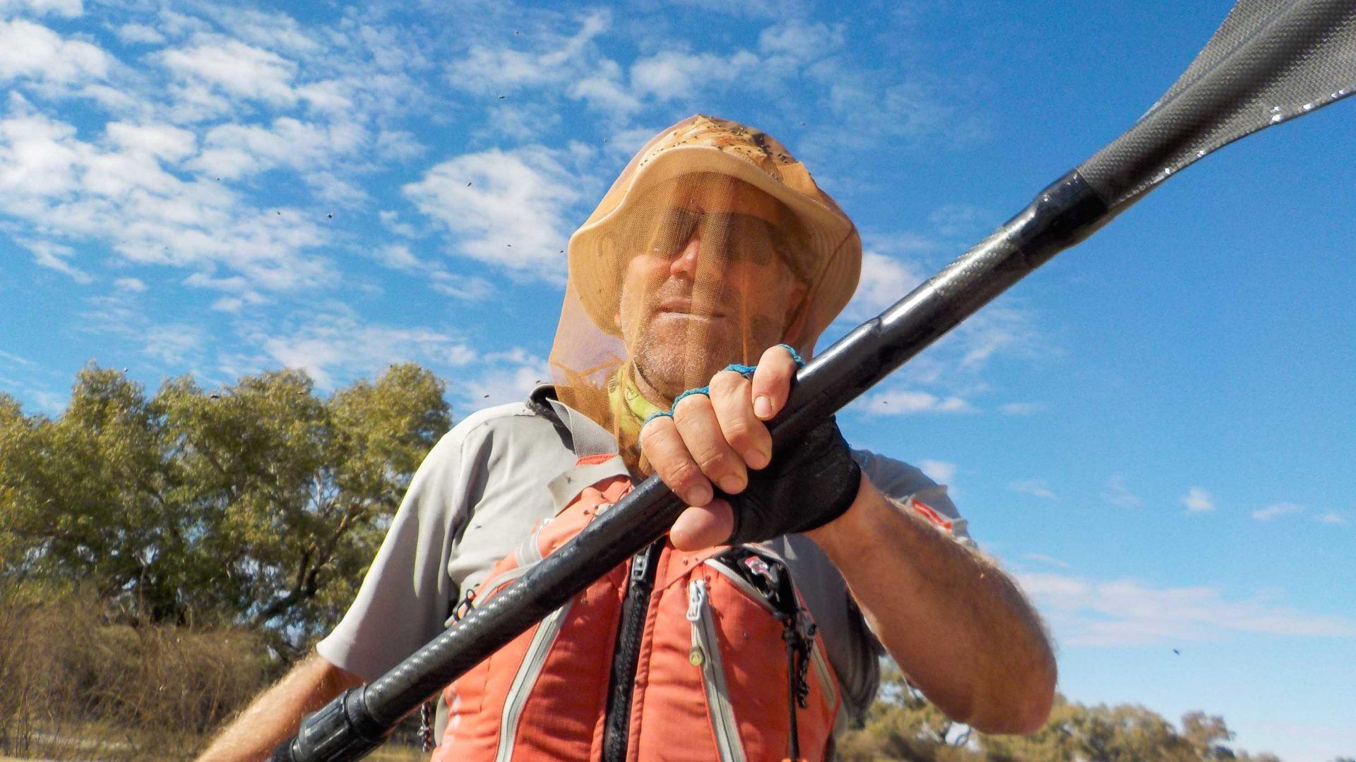 Huw Kingston paddling in the desert of South Australia.