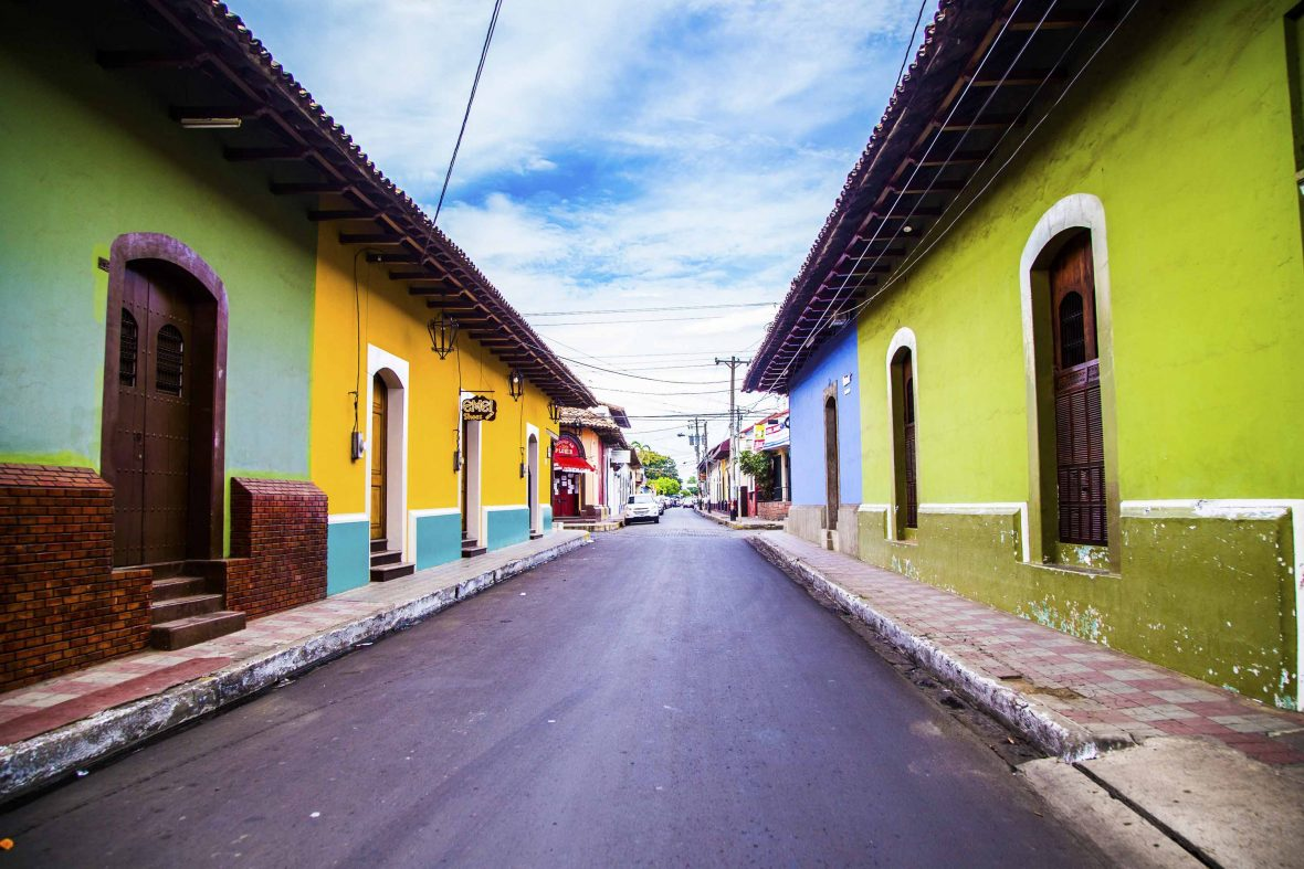 Colorful houses line the street in León, western Nicaragua.