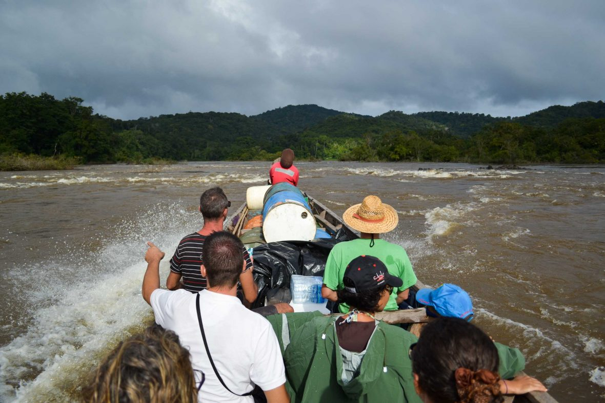 Tourists on a river trip in Guyana.