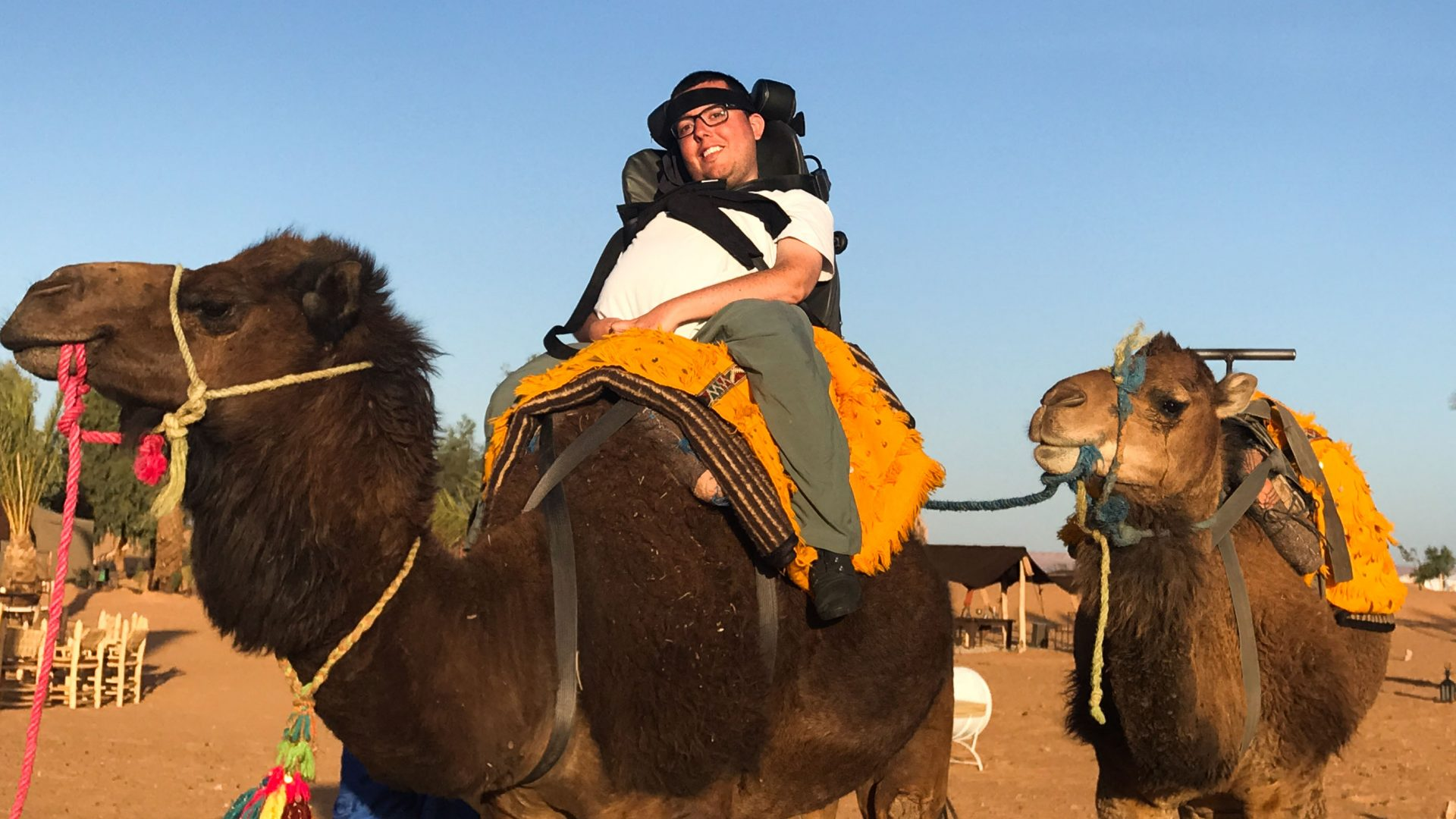 Cory Lee rides a camel during his travels.