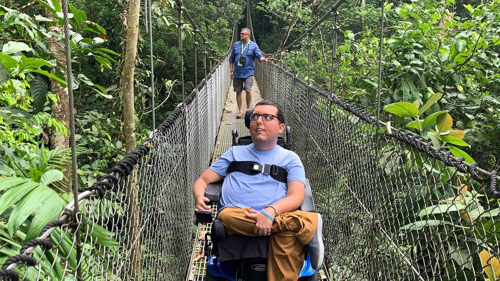 Cory Lee crossing a bridge while on his travels.