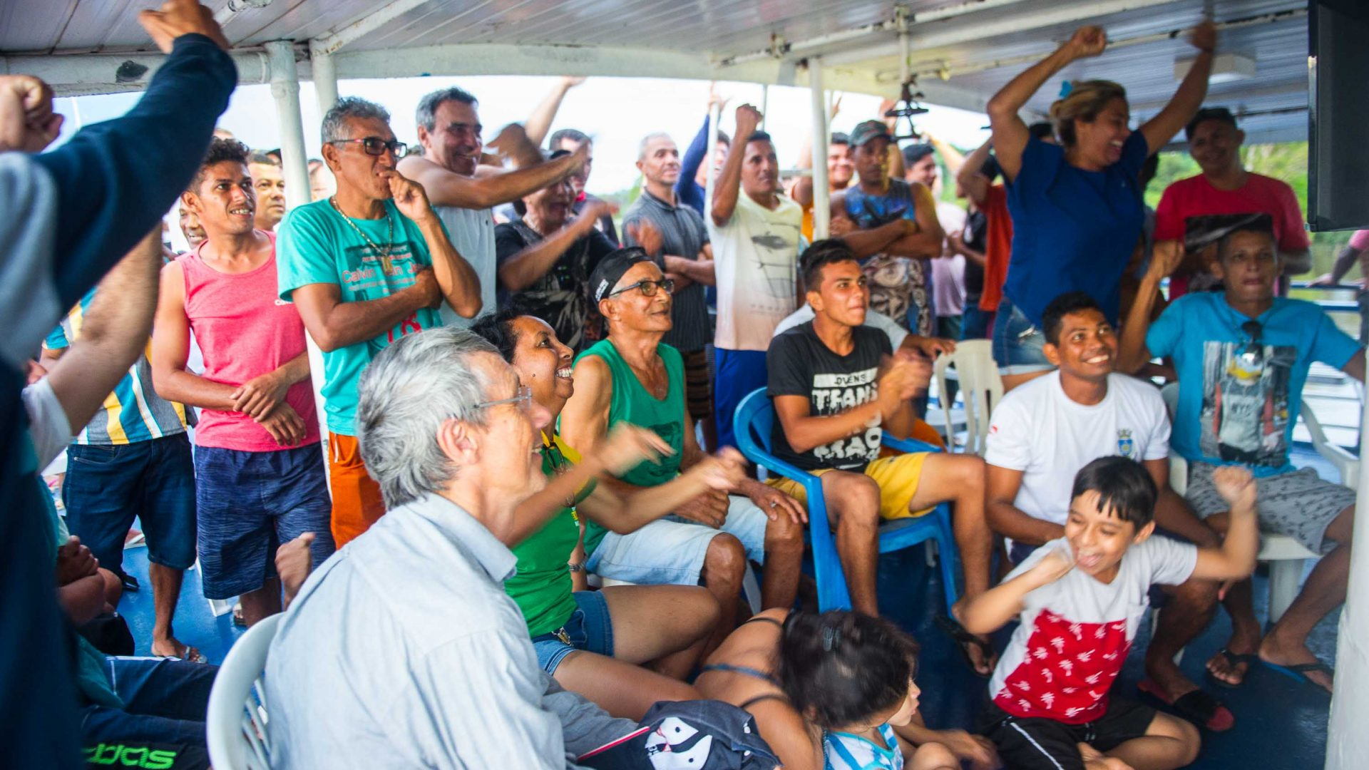 Cisne Branco riverboat passengers get rowdy while watching a soccer game on board.