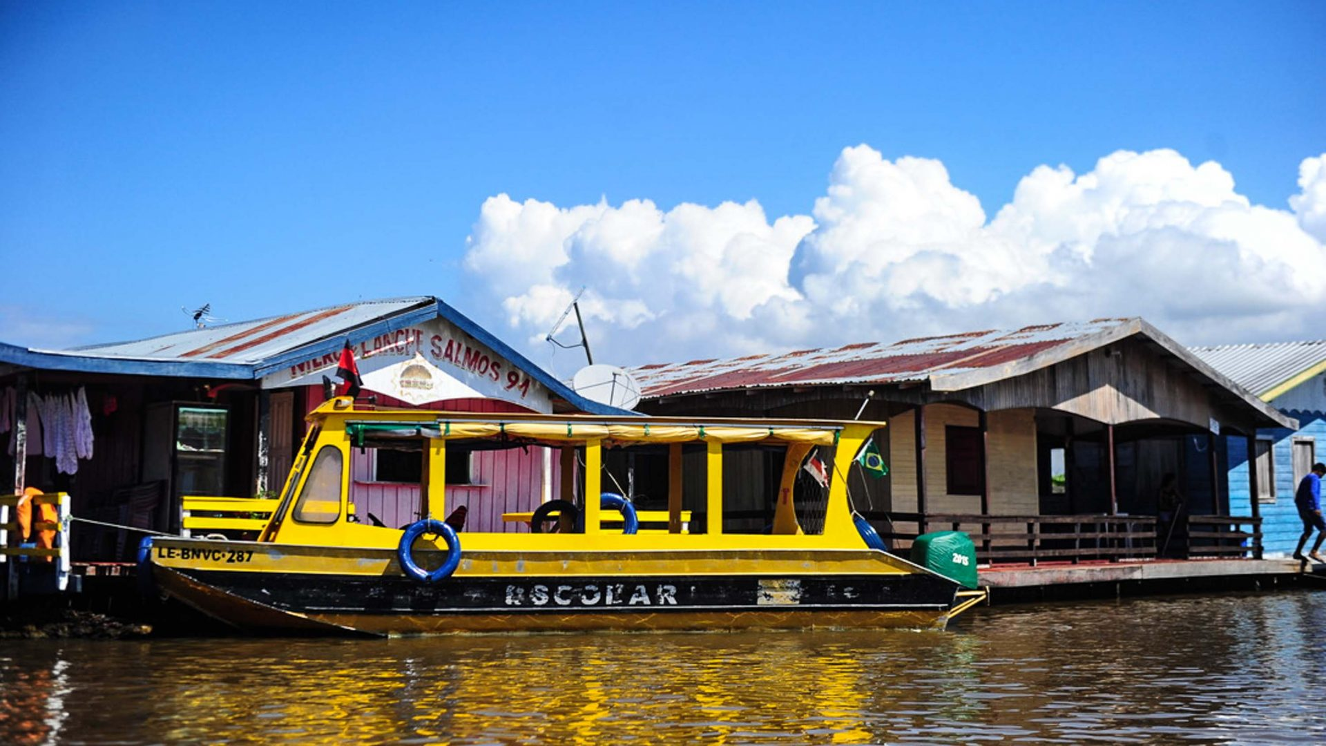 Floating farmsteads are a regular sight during this Amazon riverboat trip.