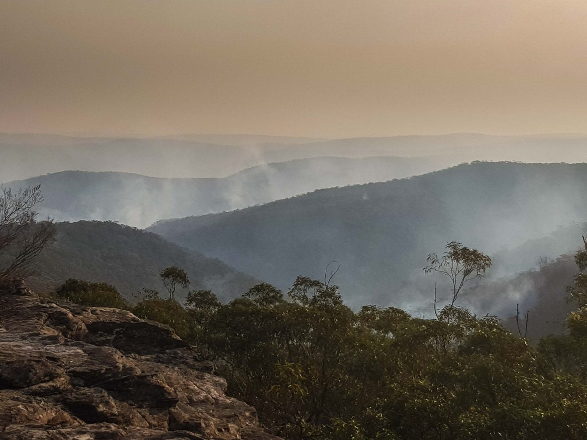 Smoke rises from the valley looking out onto Morton National Park, New South Wales.