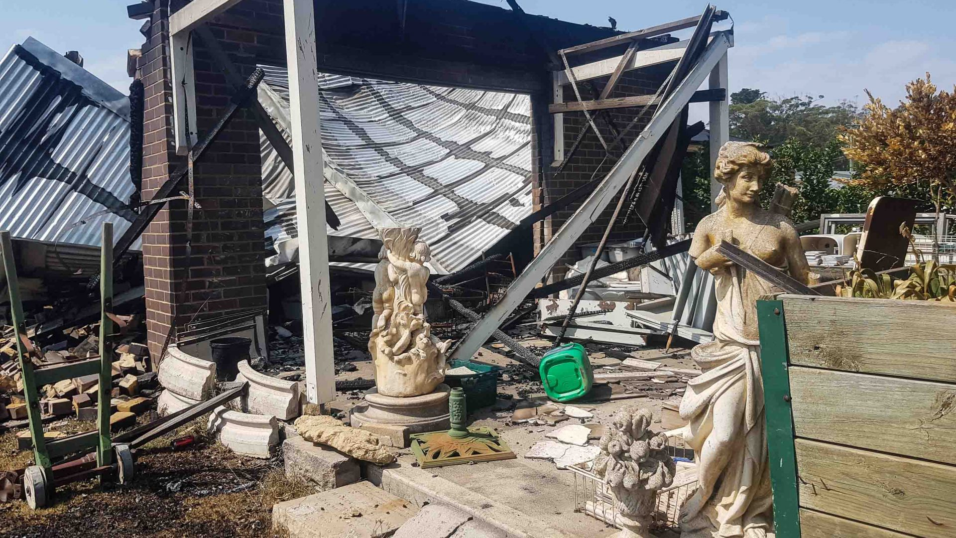 The statues are all that's left of this destroyed house.