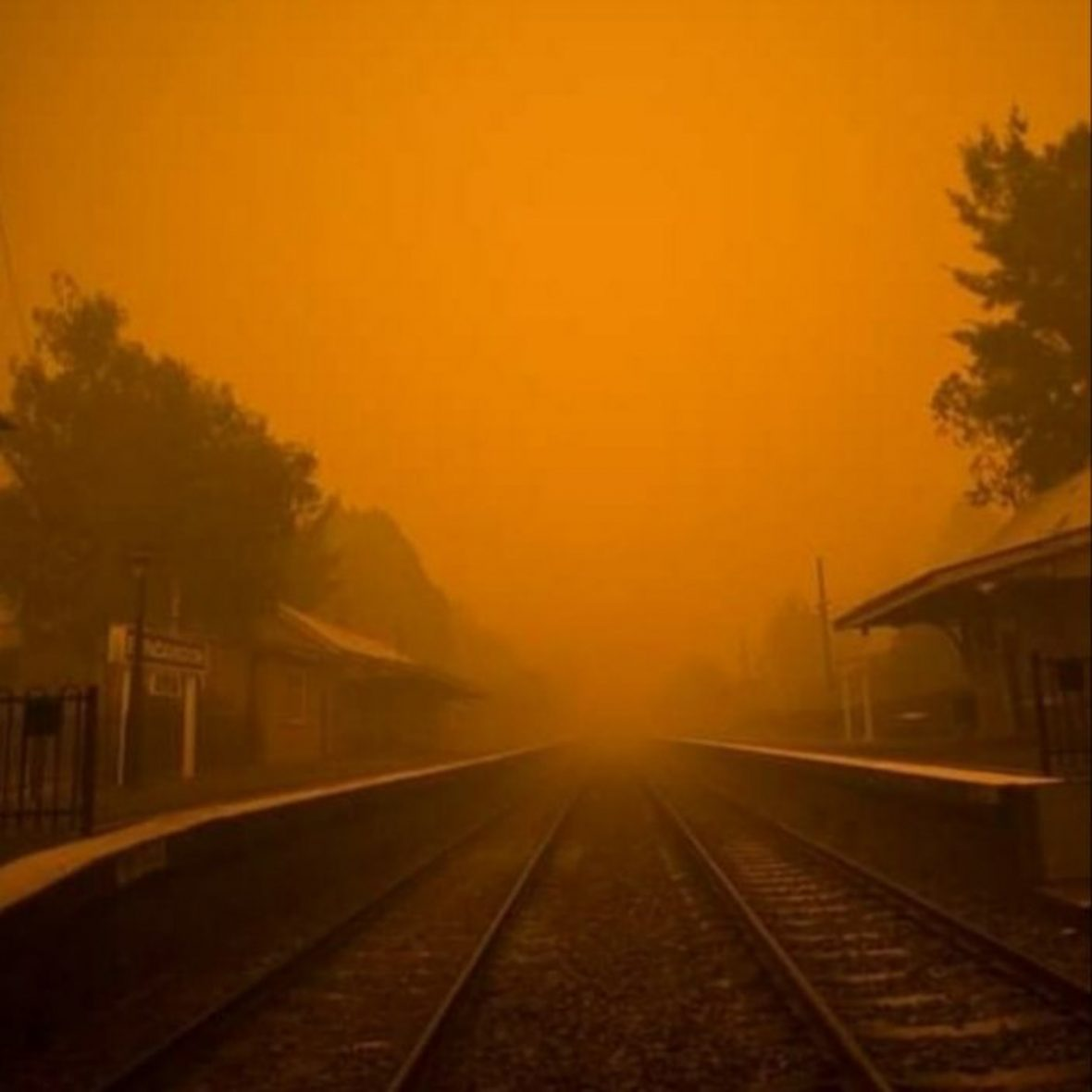 Orange smoke over Bundanoon Station and the main Melbourne to Sydney rail line.