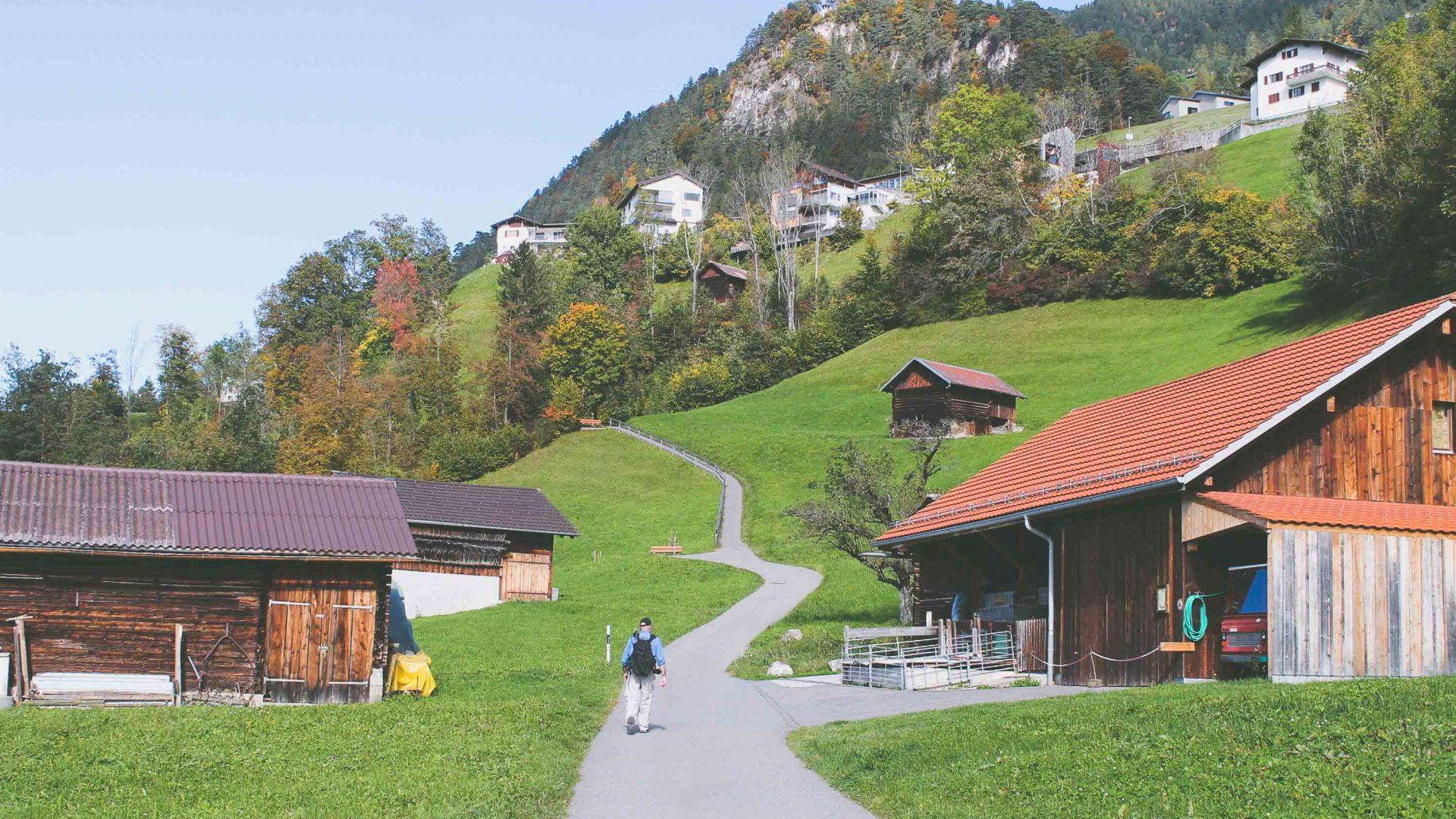 Walking along a quiet road, part of the Liechtenstein Trail.