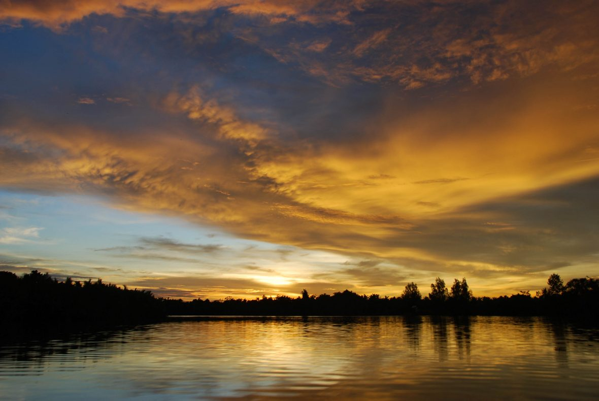 Sunset on the Kapuas River, Borneo, Indonesia.