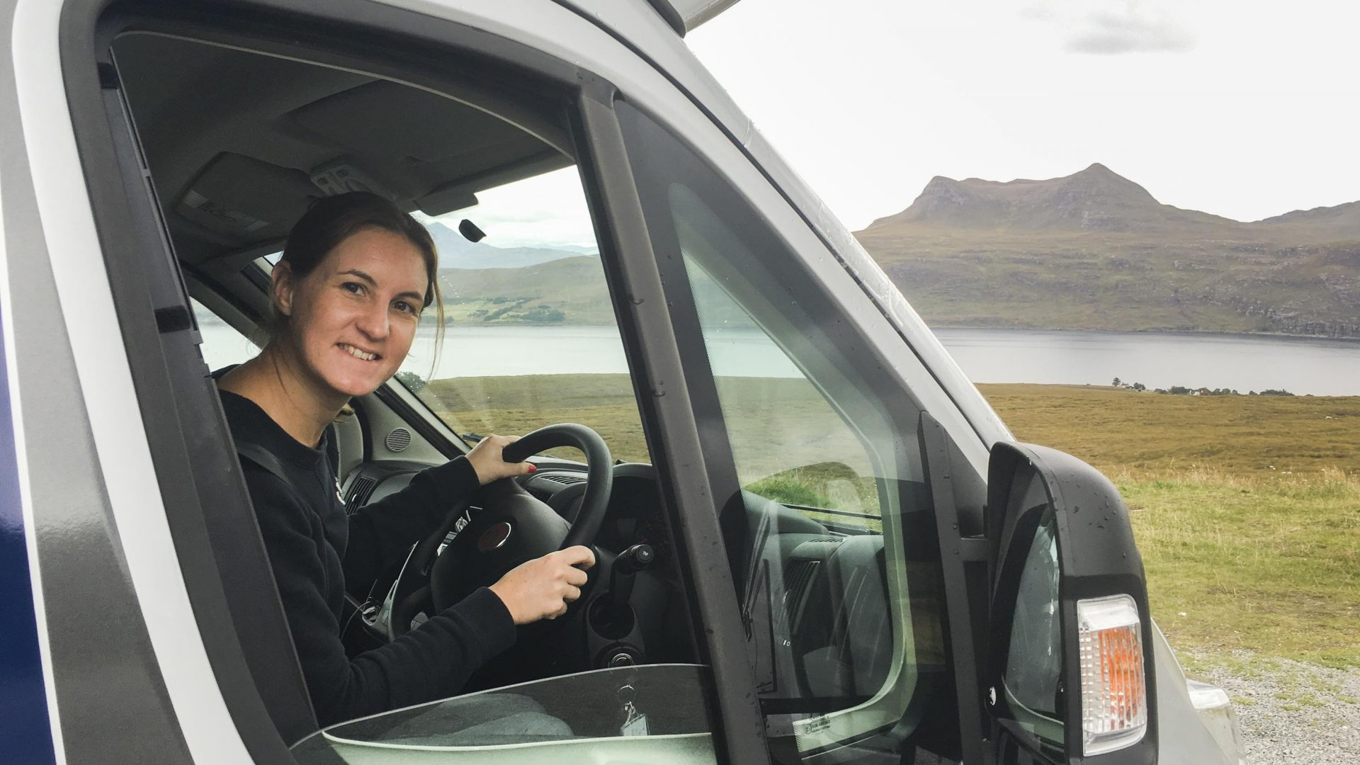 Helen Ochyra behind the wheel of a campervan near Stac Pollaidh in the northwest Highlands.