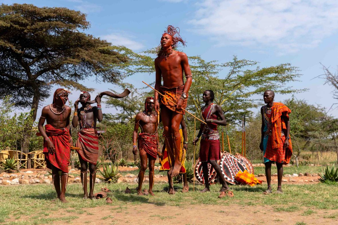 Men take part in traditional Maasai jumping in Tepesua Village, founded to educate at-risk girls.