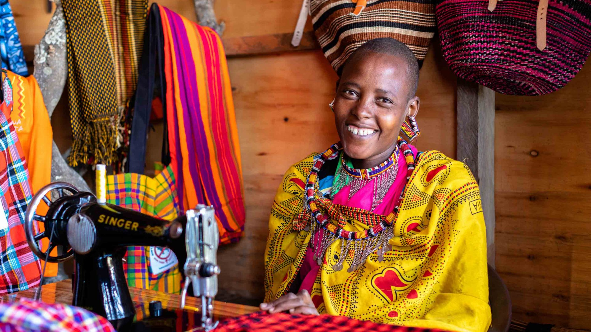 A woman at her sewing machine in the Maasai Tepesua Village.