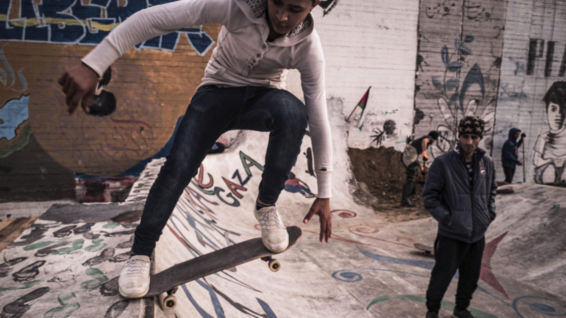 A man skates on a ramp built by the Italian NGO, ACS.