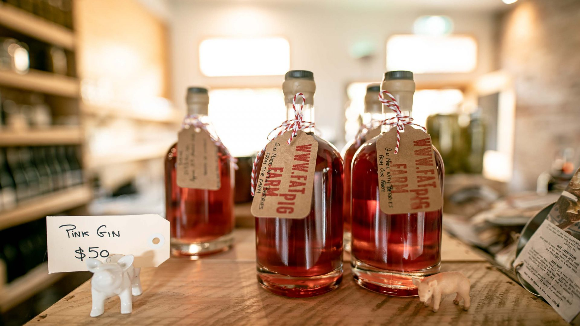 Bottles of pink coloured gin for sale.