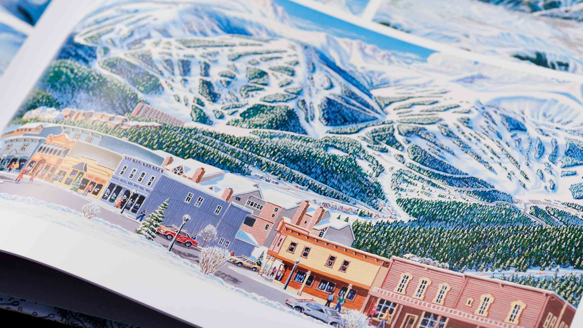 Detail of one of James's maps shows the buildings and mountains at a ski resort.