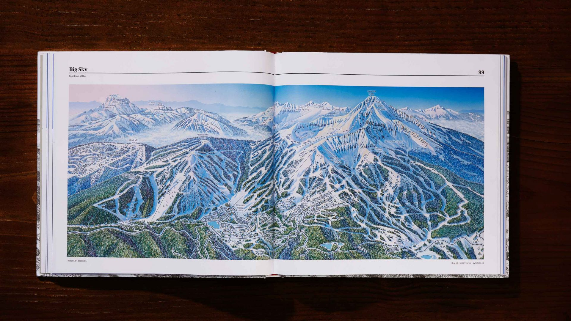 A book open showing one of the illustrated ski slopes.