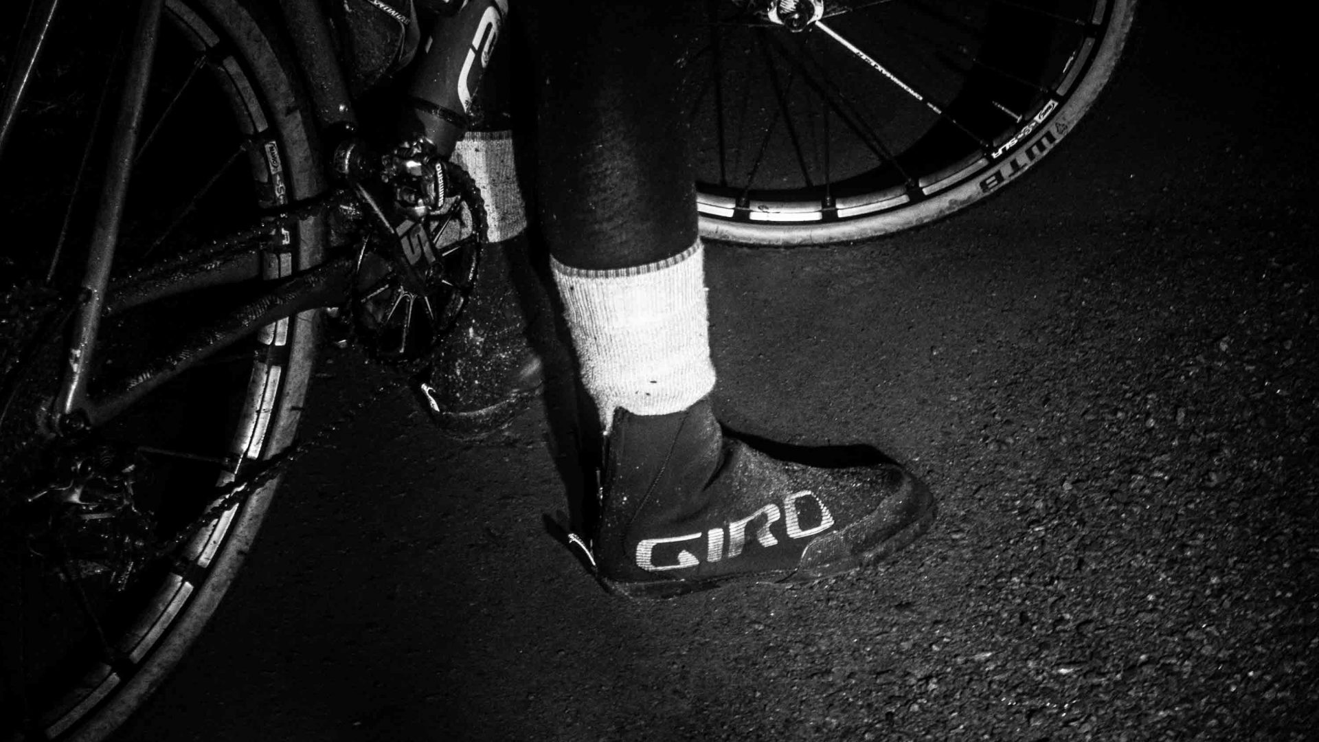A cyclist's foot on the road.