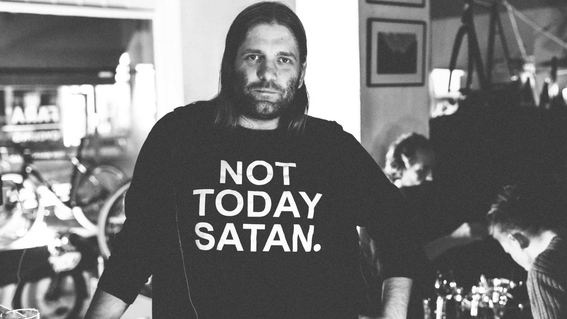 A man wearing a short that says 'Not today Satan'.