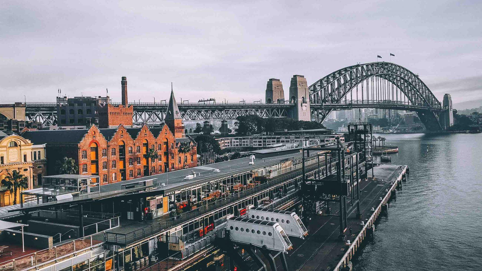 Sydney Harbour Bridge seen in the distance.