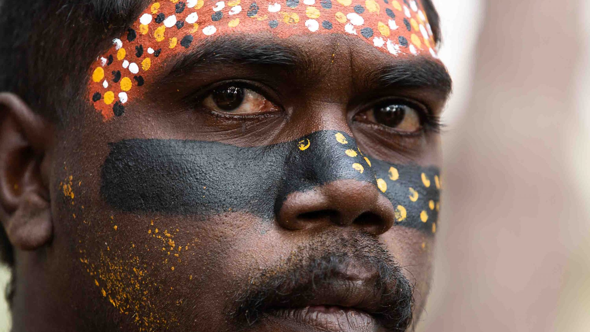A close up of a painted man's face.
