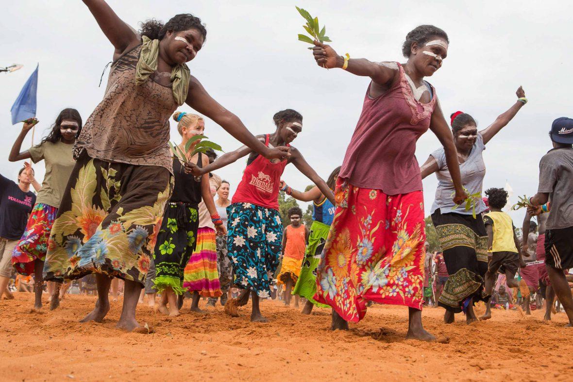 Women dancing together.